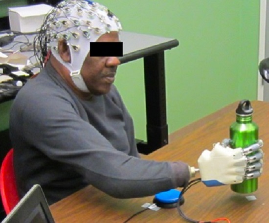 New University of Houston research has demonstrated that an amputee can grasp with a bionic hand, powered only by his thoughts.  Credit: University of Houston.